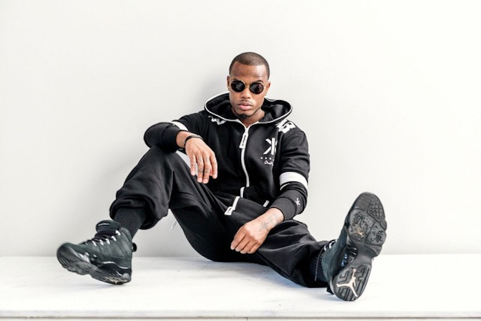 b.o.b wearing college black onepiece jumpsuit