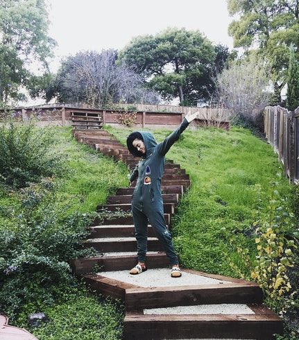 Kehlani wearing aviator jumpsuit jungle green